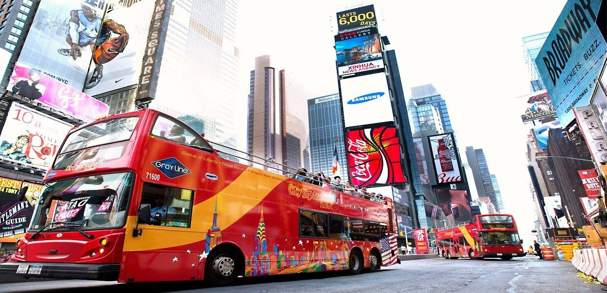 "Downtown Manhattan is the heart and soul of the ""City that Never Sleeps,"" which makes it the perfect place to experience New York City's iconic sights! On our double-decker Downtown Tour, you'll begin in world-famous Times Square, where bright lights and billboards set ."